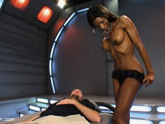 Sexy and powerful, Natassia Dreams, ass fucks a slave boy who grits and bears it until he cums a massive load all over himself.